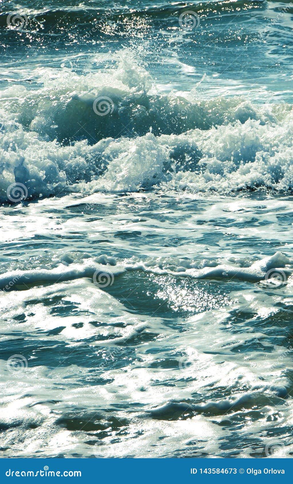 Sea wave splashing water.Blue blue photo.