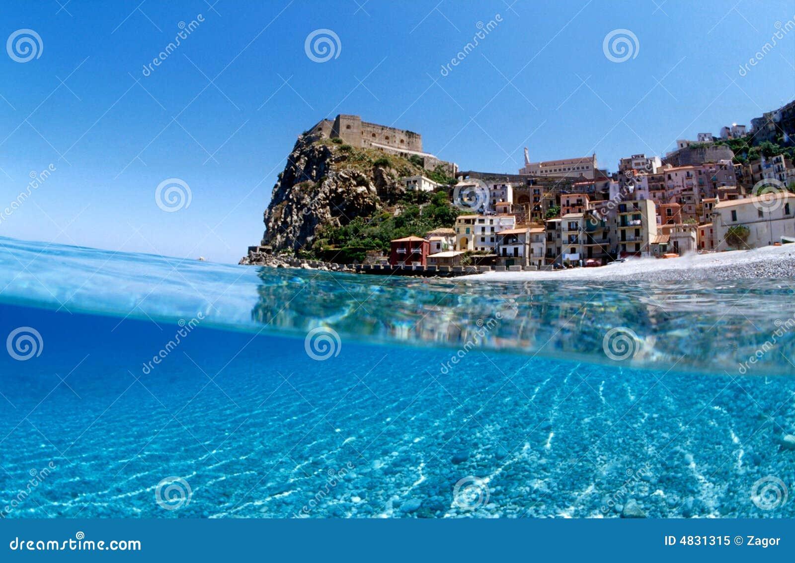 Sea wave under the castle