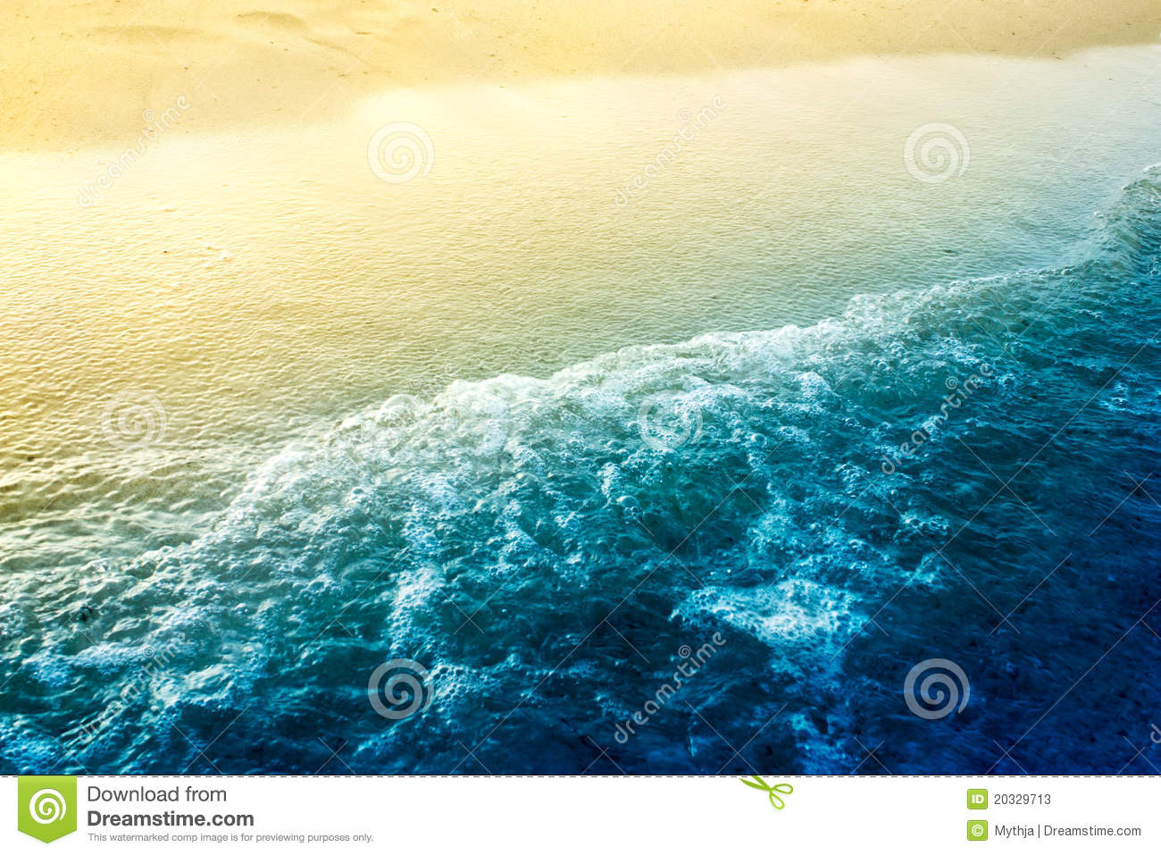 Sea waves with golden sand