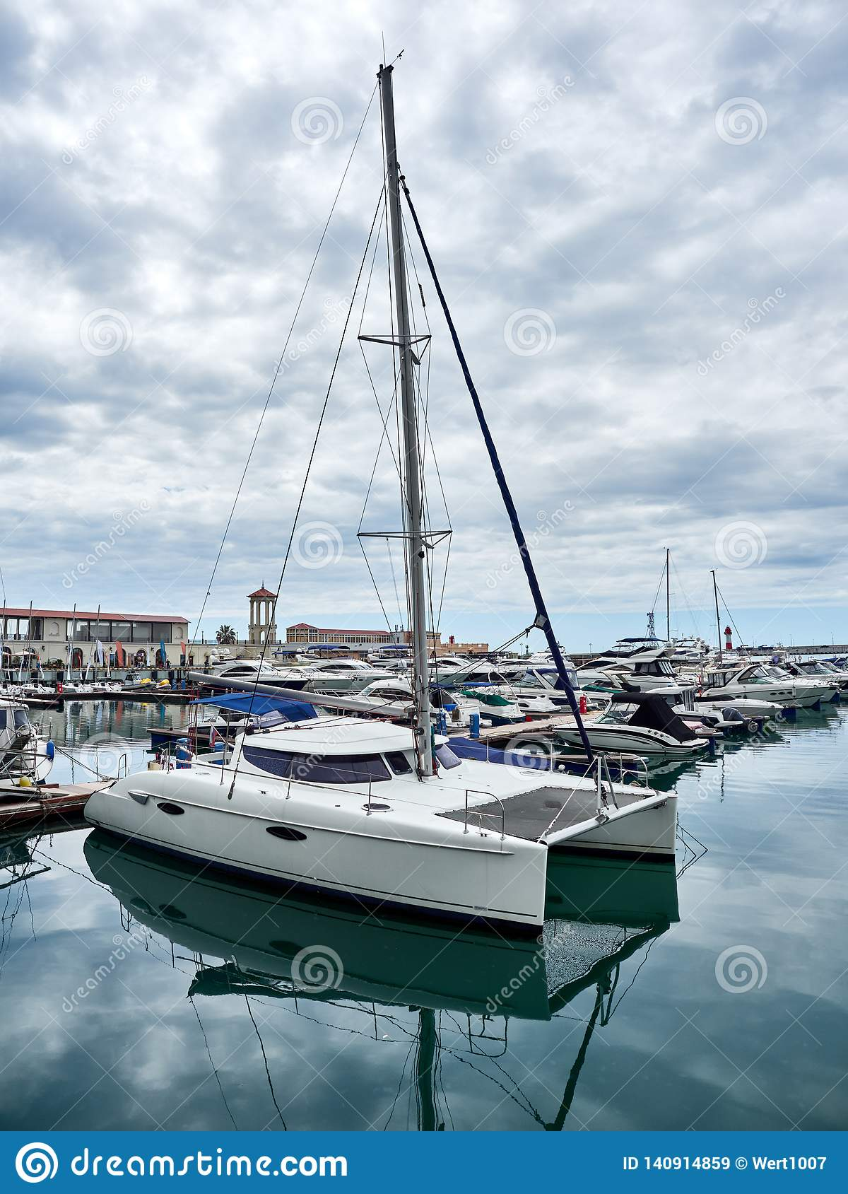 Sea yacht-catamaran docked in port