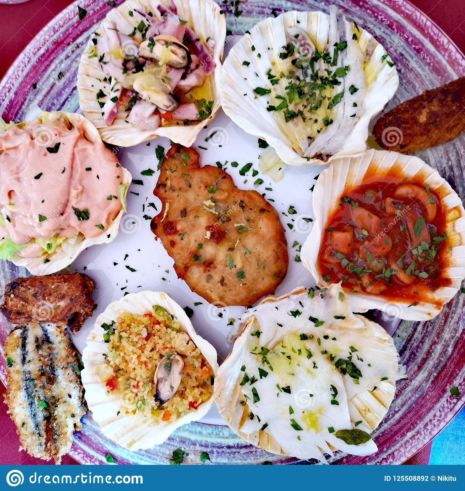 Seafood appetizers on scallop shells