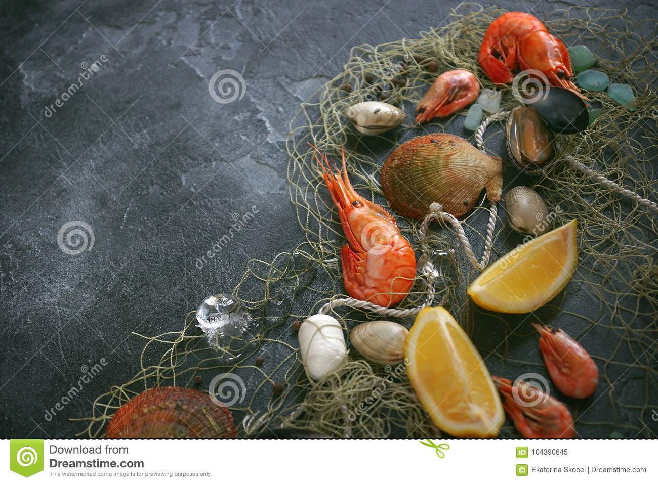 Seafood on a dark background, Shrimps, mussels, mussels on black stone, Copy space