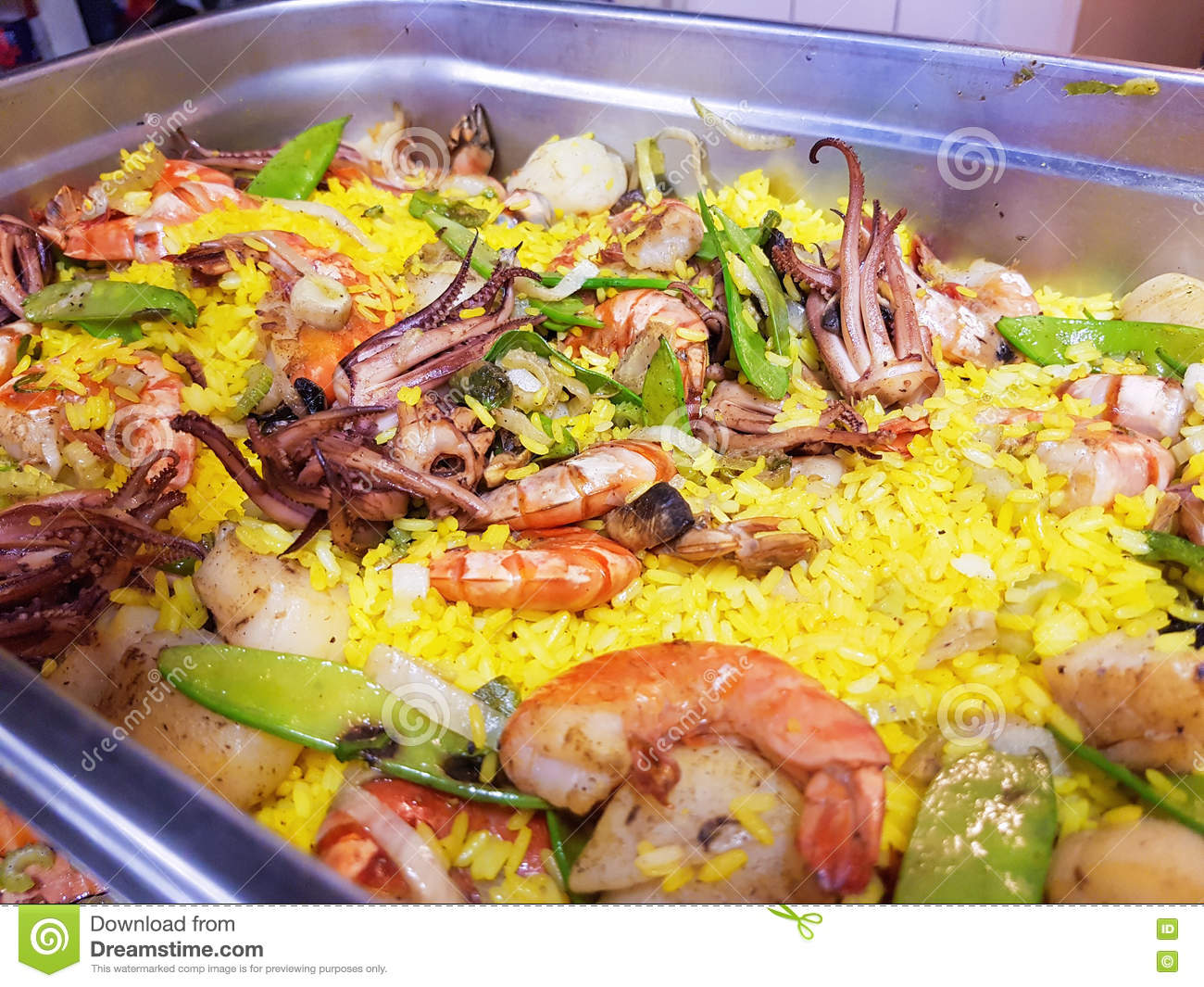 Fresh seafood paella, with octopus, scallop, shrimp and salmon.