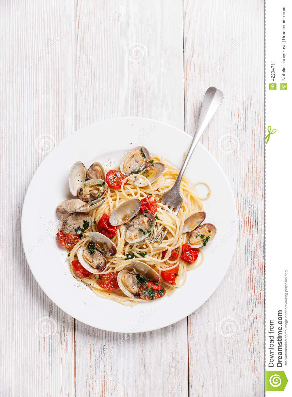 Seafood pasta with clams in tomato sauce Spaghetti Vongole on white ...