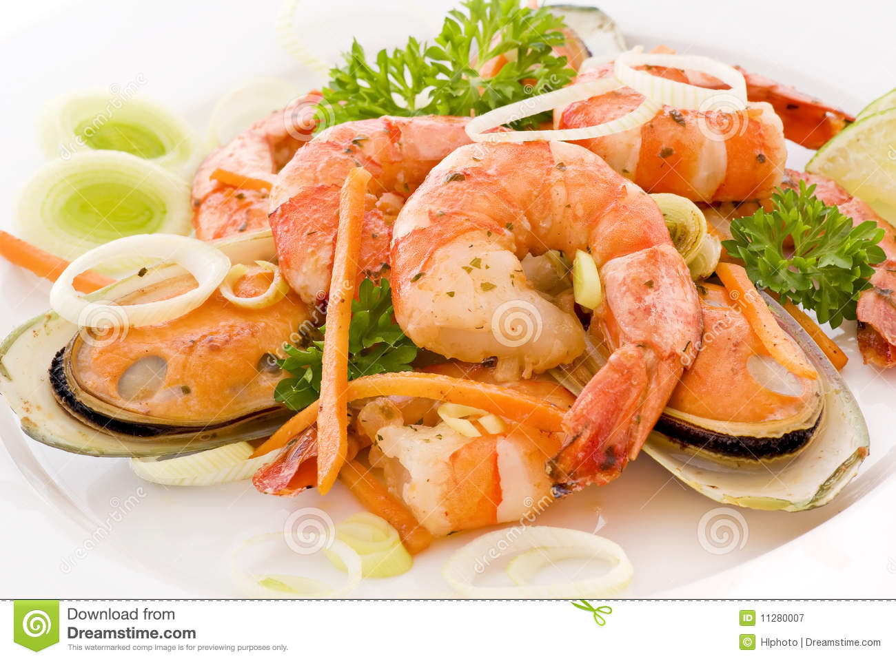 Seafood platter with prawns and mussels and white asparagus as closeup ...