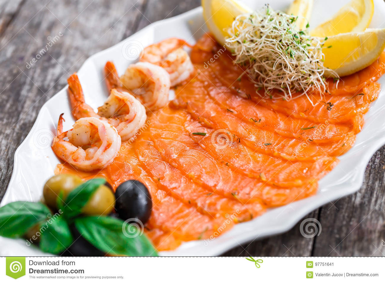 Seafood Platter With Salmon Slice And Shrimp Decorated With Olives And Lemon On Wooden Background Close Up Stock Image Image Of Appetizer Meal 97751641