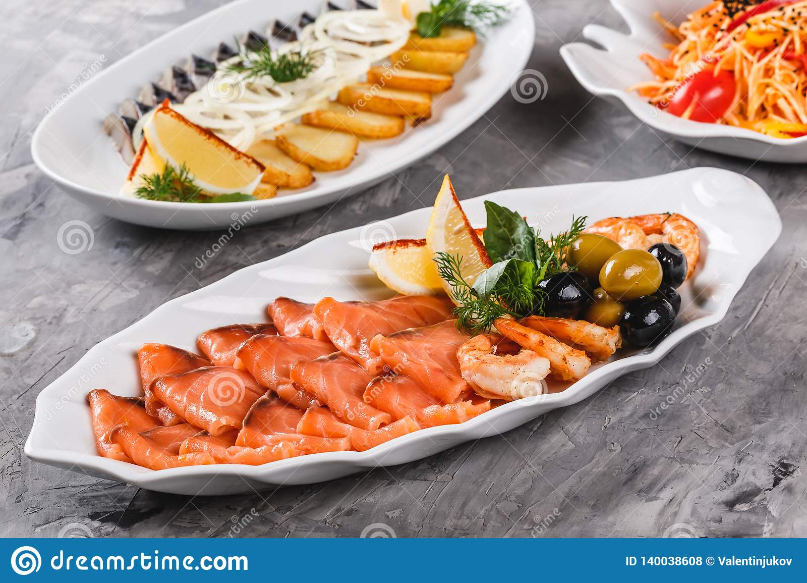 Seafood Platter With Salmon Slice Shrimp Slices Fish Fillet Decorated With Olives And Lemon In Plate Over Rustic Background Stock Photo Image Of Meal Background 140038608