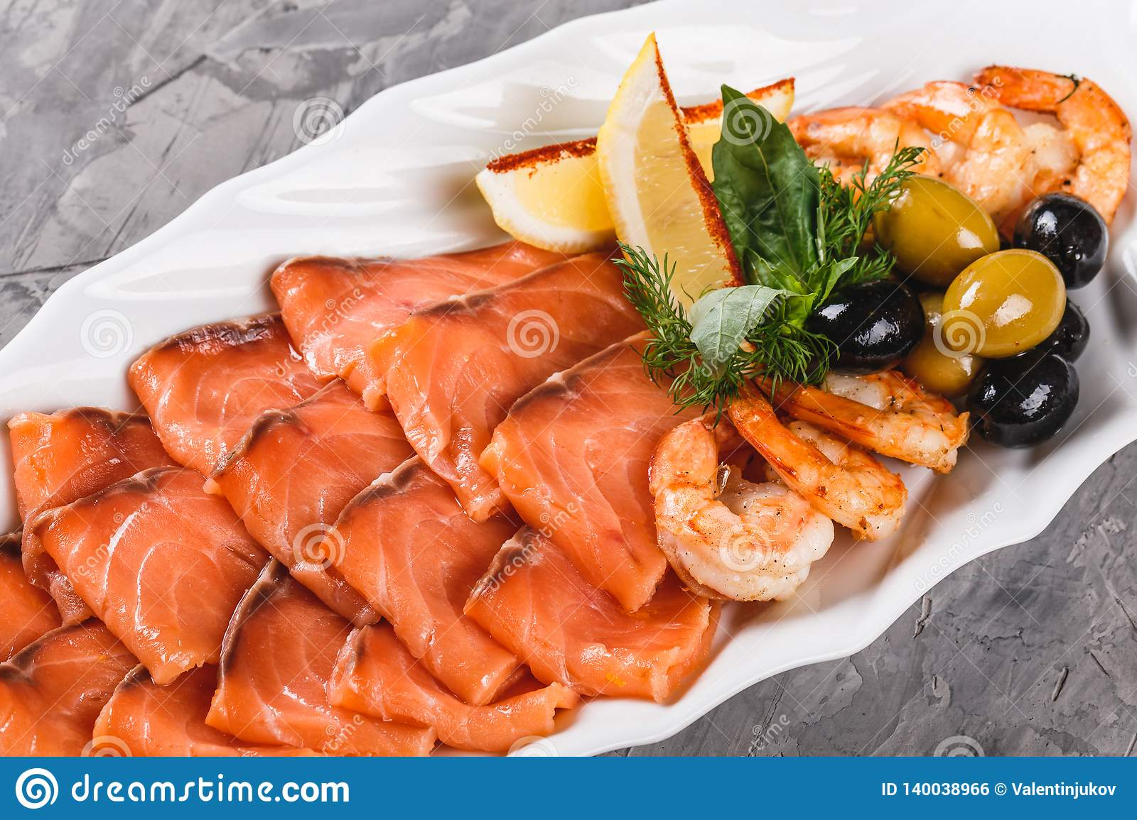 Seafood Platter With Salmon Slice Shrimp Slices Fish Fillet Decorated With Olives And Lemon In Plate Over Rustic Background Stock Photo Image Of Assorted Green 140038966