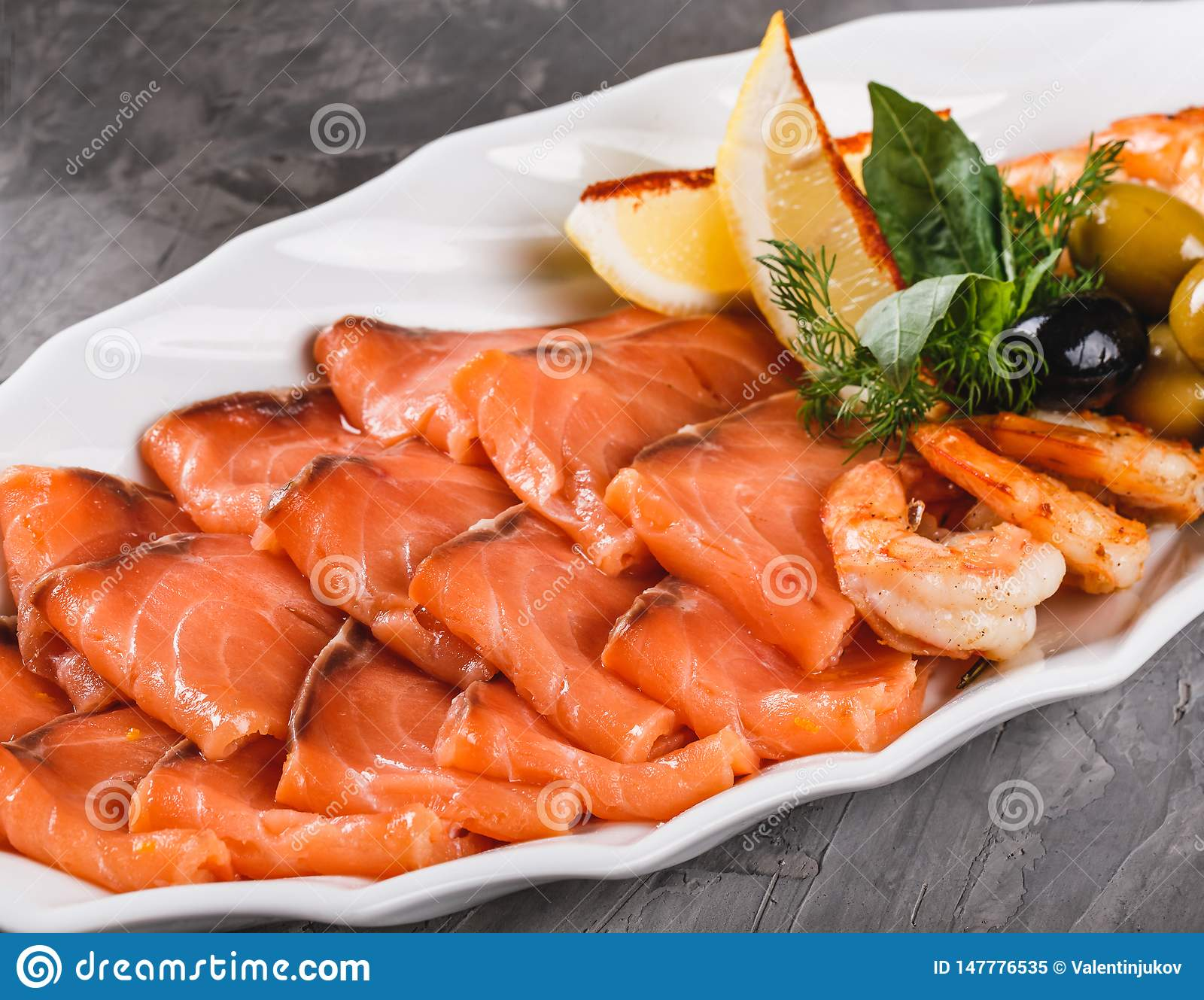 Seafood Platter With Salmon Slice Shrimp Slices Fish Fillet Decorated With Olives And Lemon In Plate Over Rustic Background Stock Image Image Of Salmon Seafood 147776535