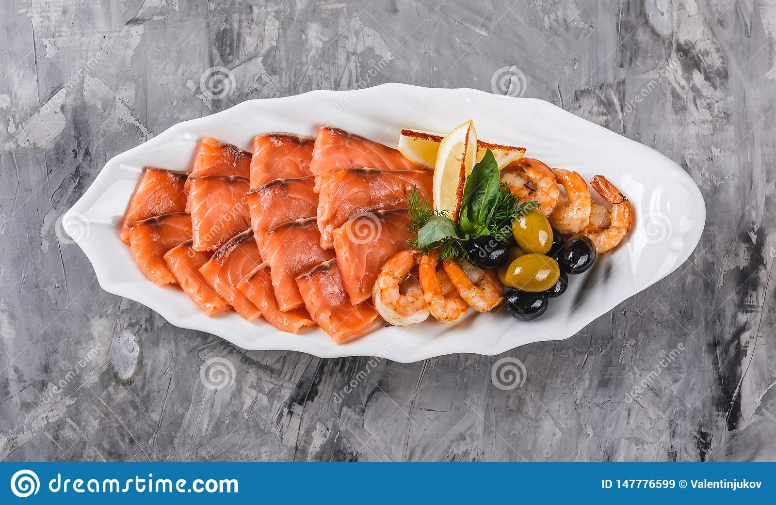Seafood Platter With Salmon Slice Shrimp Slices Fish Fillet Decorated With Olives And Lemon In Plate Over Rustic Background Stock Image Image Of Freshness Dish 147776599
