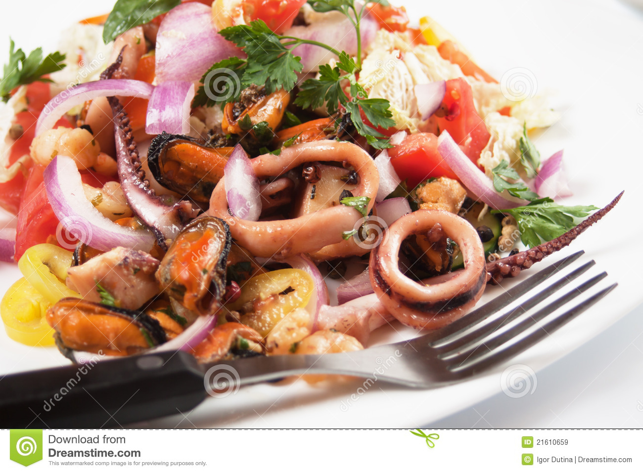 Seafood salad with squid rings, mussel, shrimp and vegetables.