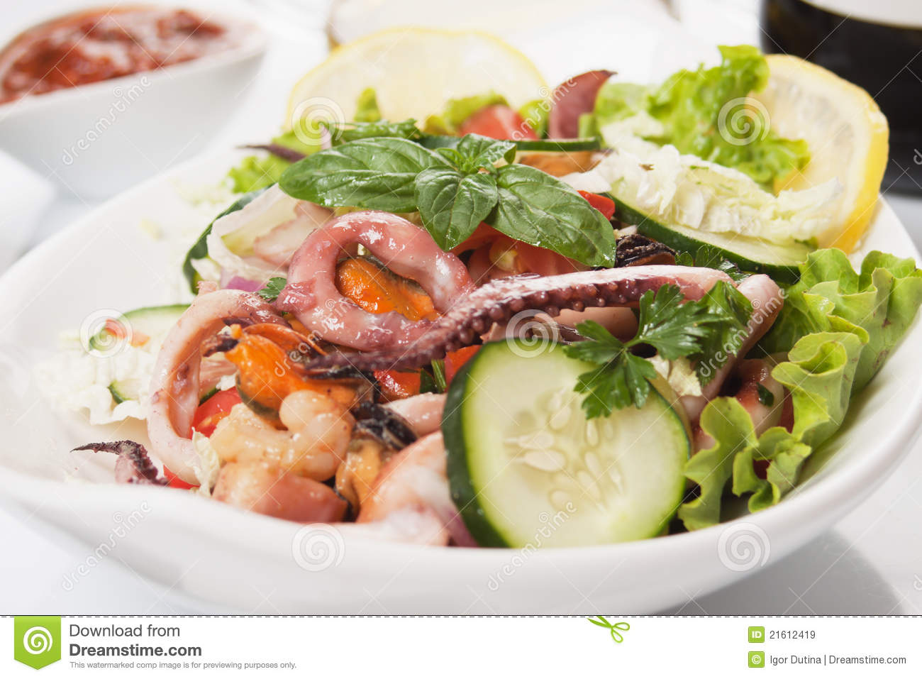 Seafood salad with squid, shrimp, mussel, and fresh vegetable.