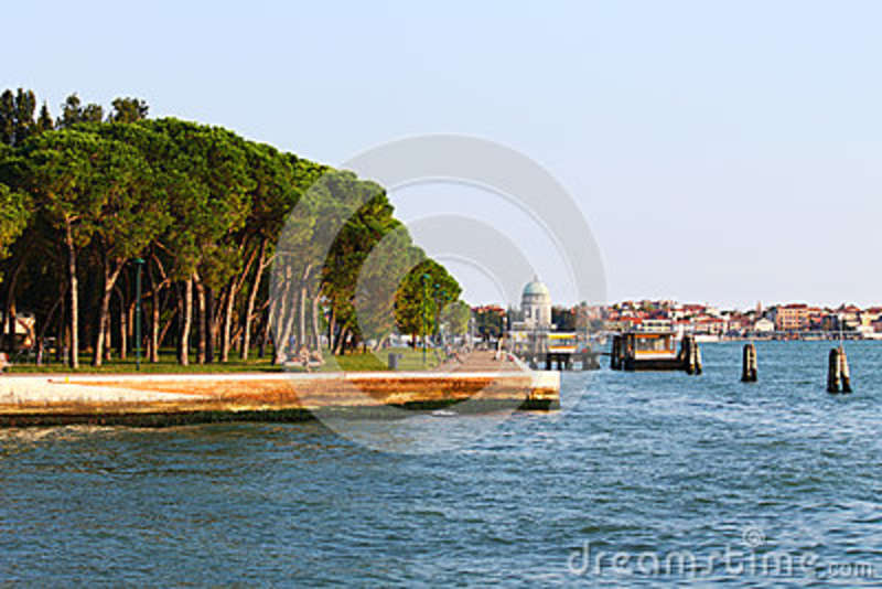 Seafront with trees and buildings on water