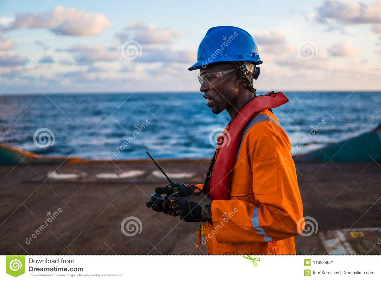 Seaman AB Or Bosun On Deck Of Vessel Or Ship , Wearing PPE