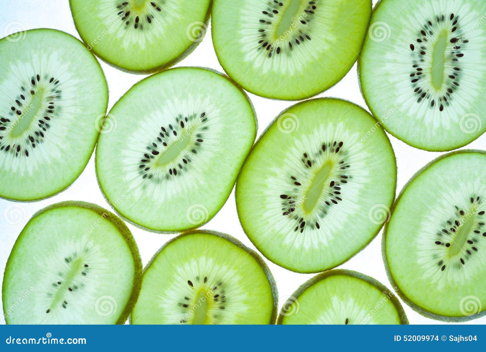 Seamless pattern of sliced green kiwifruit