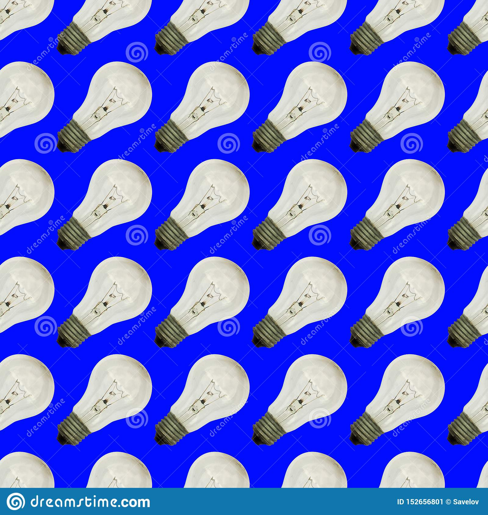 Seamless pattern of vintage light bulbs on a blue color