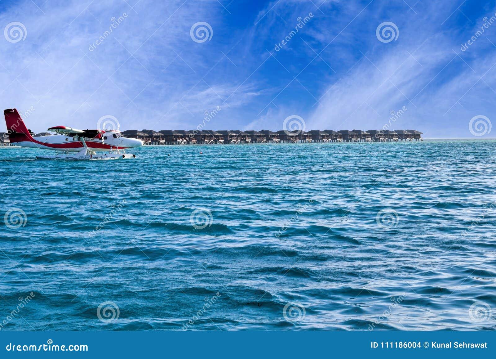 Seaplane And Water Villas At Beautiful Maldives Island