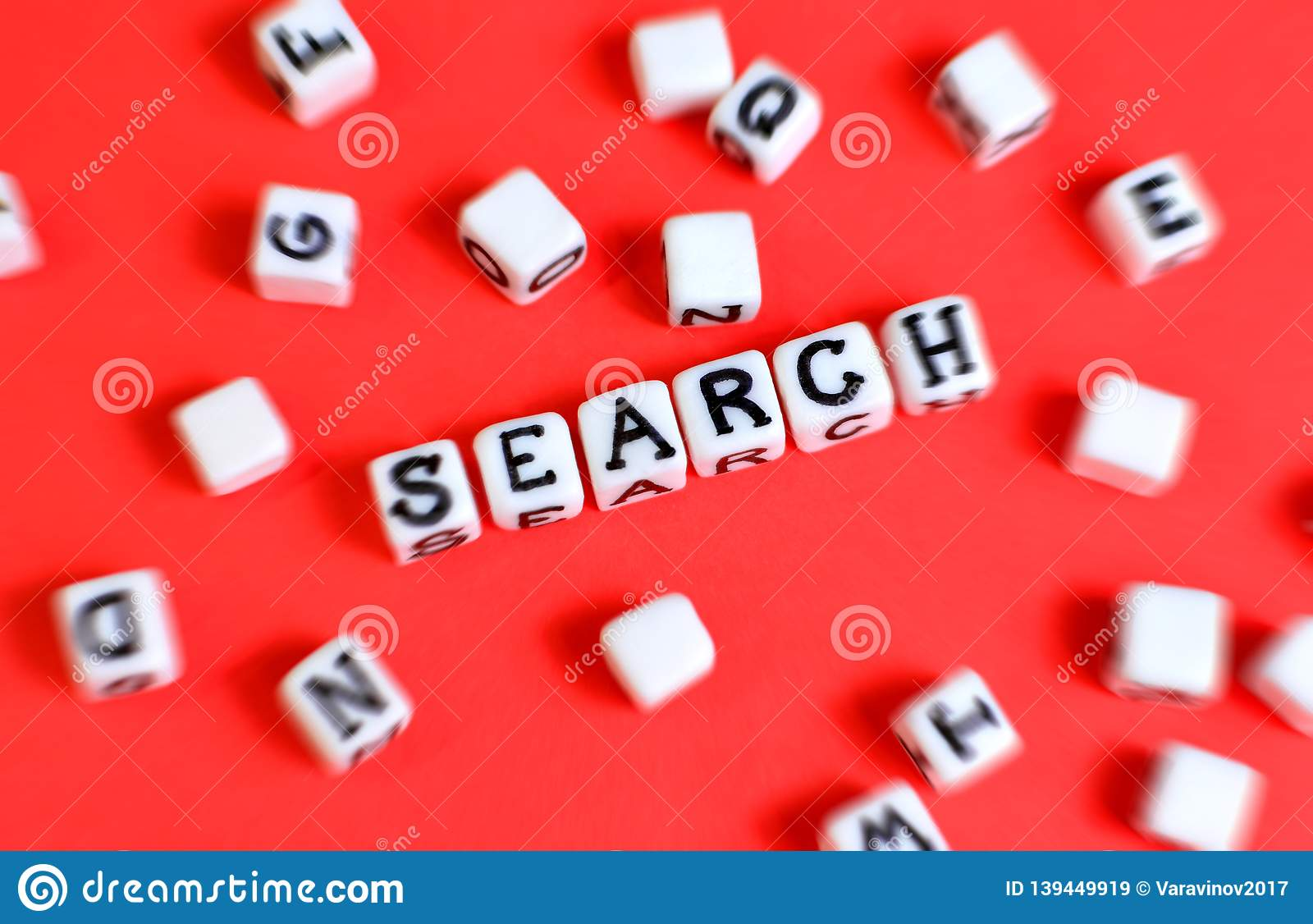Search concept with cubes `Search` word and other defocused cubes.