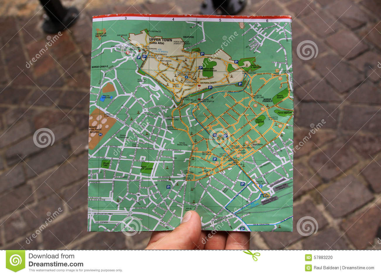 Searching for directions on a city map with hand