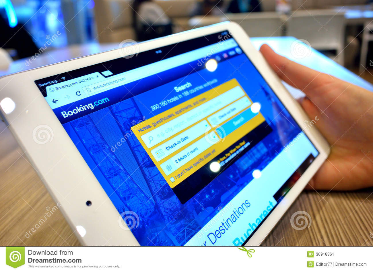 Searching hotel accommodation editorial photo image for Tablet hotel booking