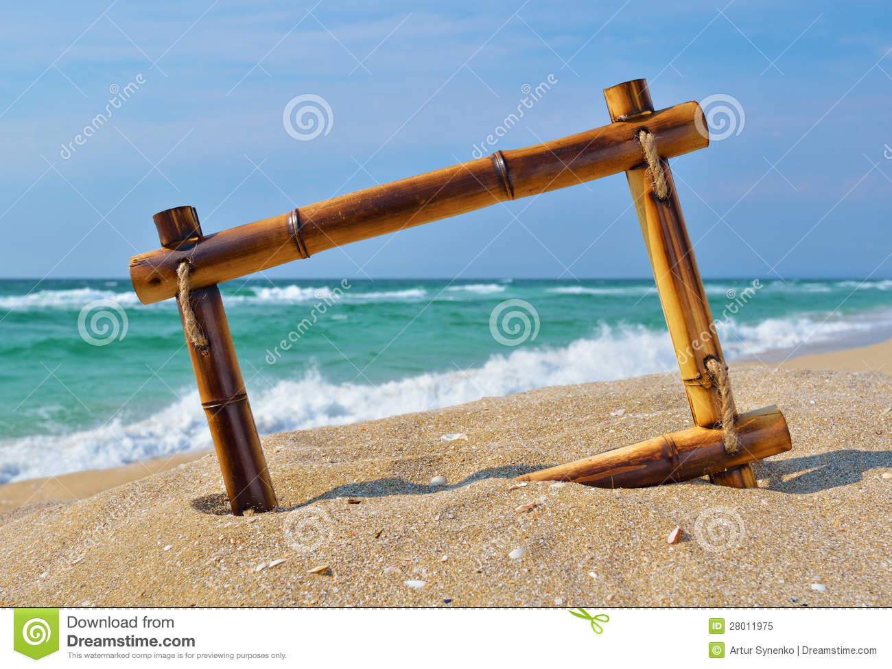 seascape with bamboo frame on the beach sand