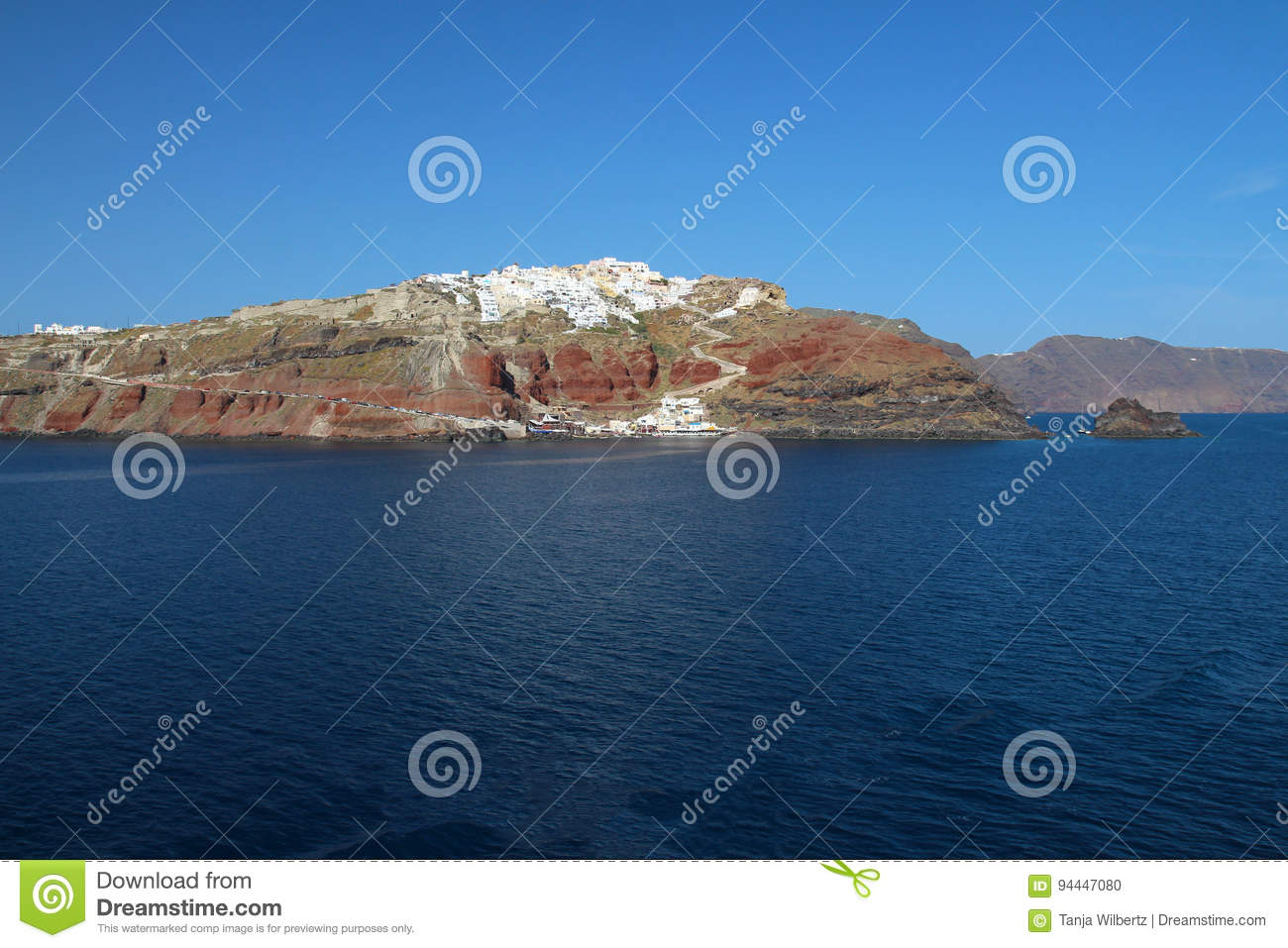 Seascape view of Oia - Liitle Town on mountain top in Santorin