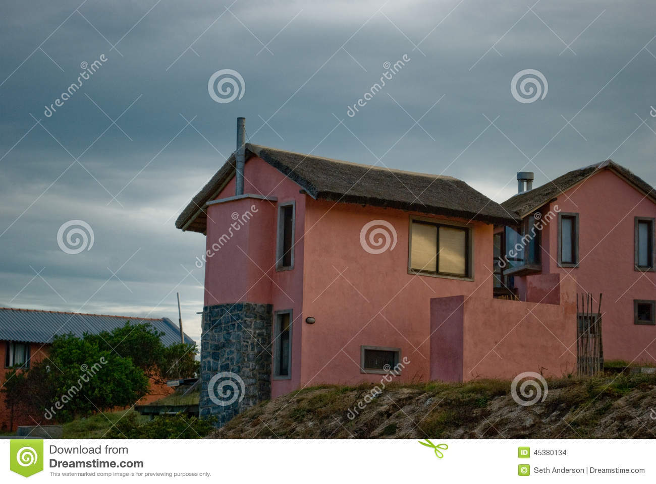 Seaside Cottage With Thatched Grass Roof Stock Photo