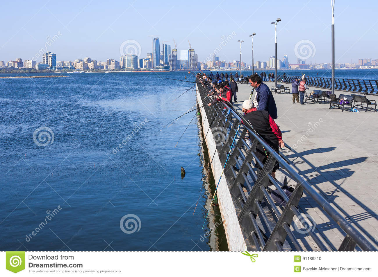 Seaside Park, Baku, Azerbaijan - April 17, 2017. A group of anglers are fishing in the Caspian Sea from the pier.