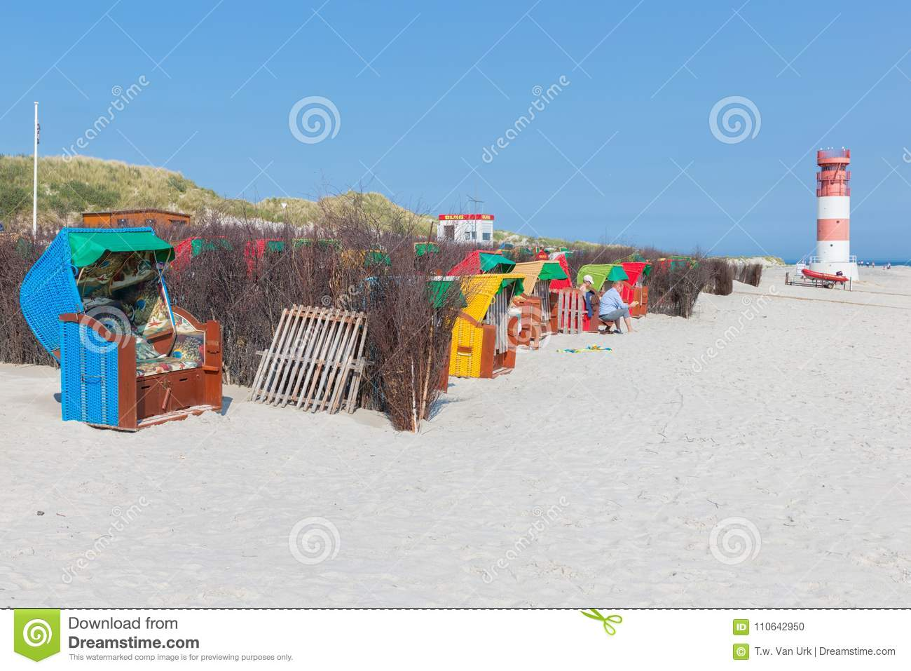Seaside visitors in colorful beach chairs at German island Dune