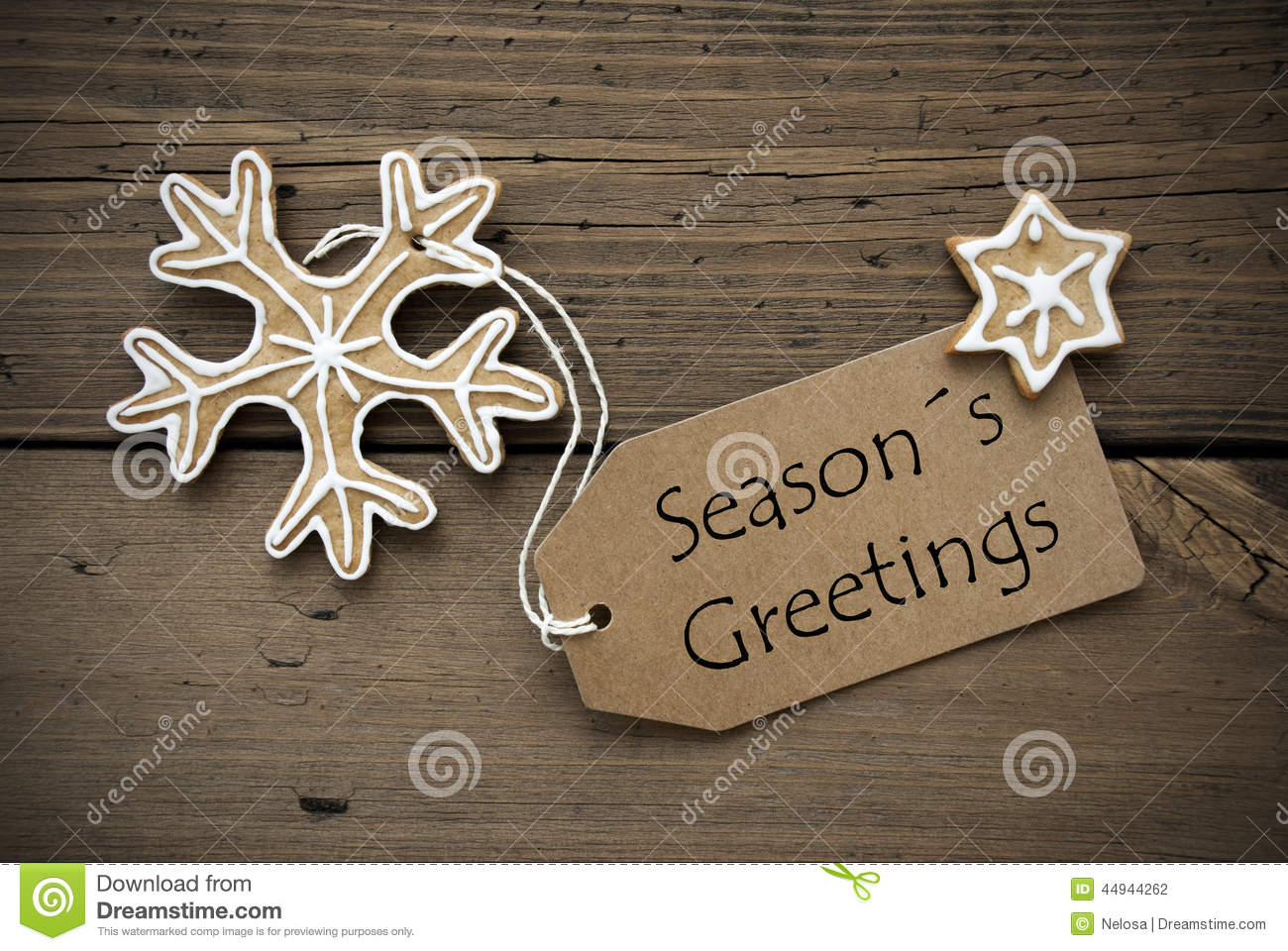 Seasons greetings on a banner with ginger bread cookies stock royalty free stock photo kristyandbryce Choice Image