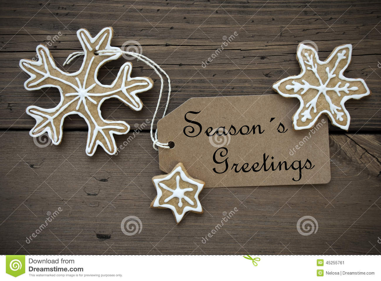 Seasons greetings on a label with ginger bread cookies stock image royalty free stock photo kristyandbryce Images