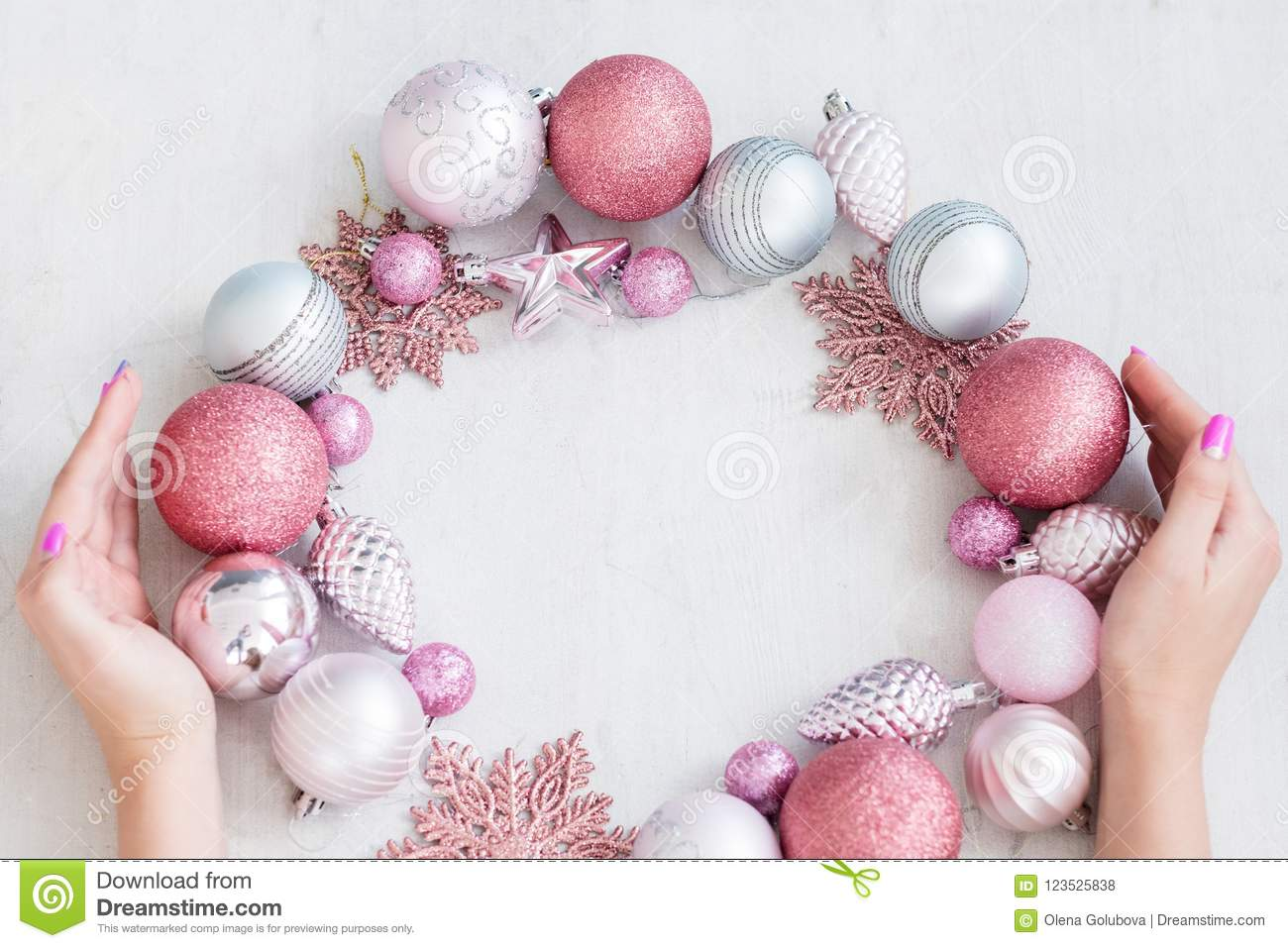 Seasonal decor christmas background hands wreath