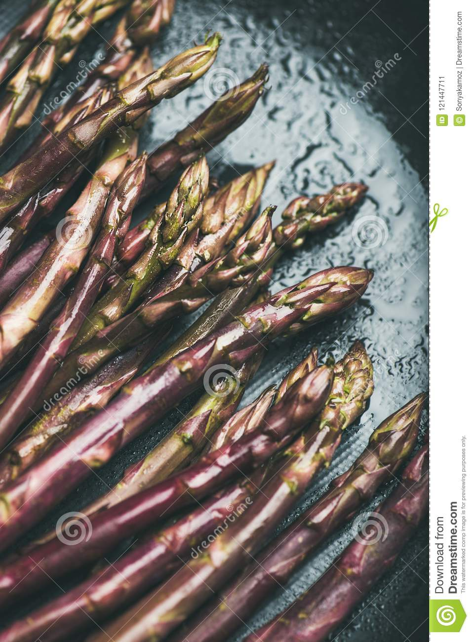 Fresh Raw Uncooked Purple Asparagus Over Dark Background Stock Image