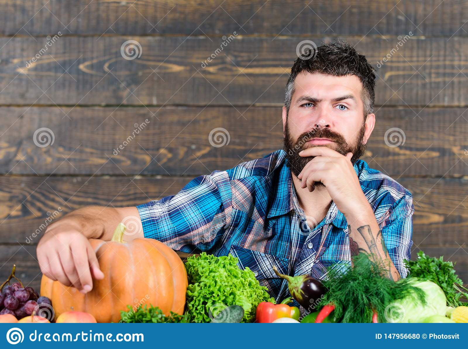 Seasonal vitamin food. Useful fruit and vegetable. organic and natural food. happy halloween. man with rich autumn crop