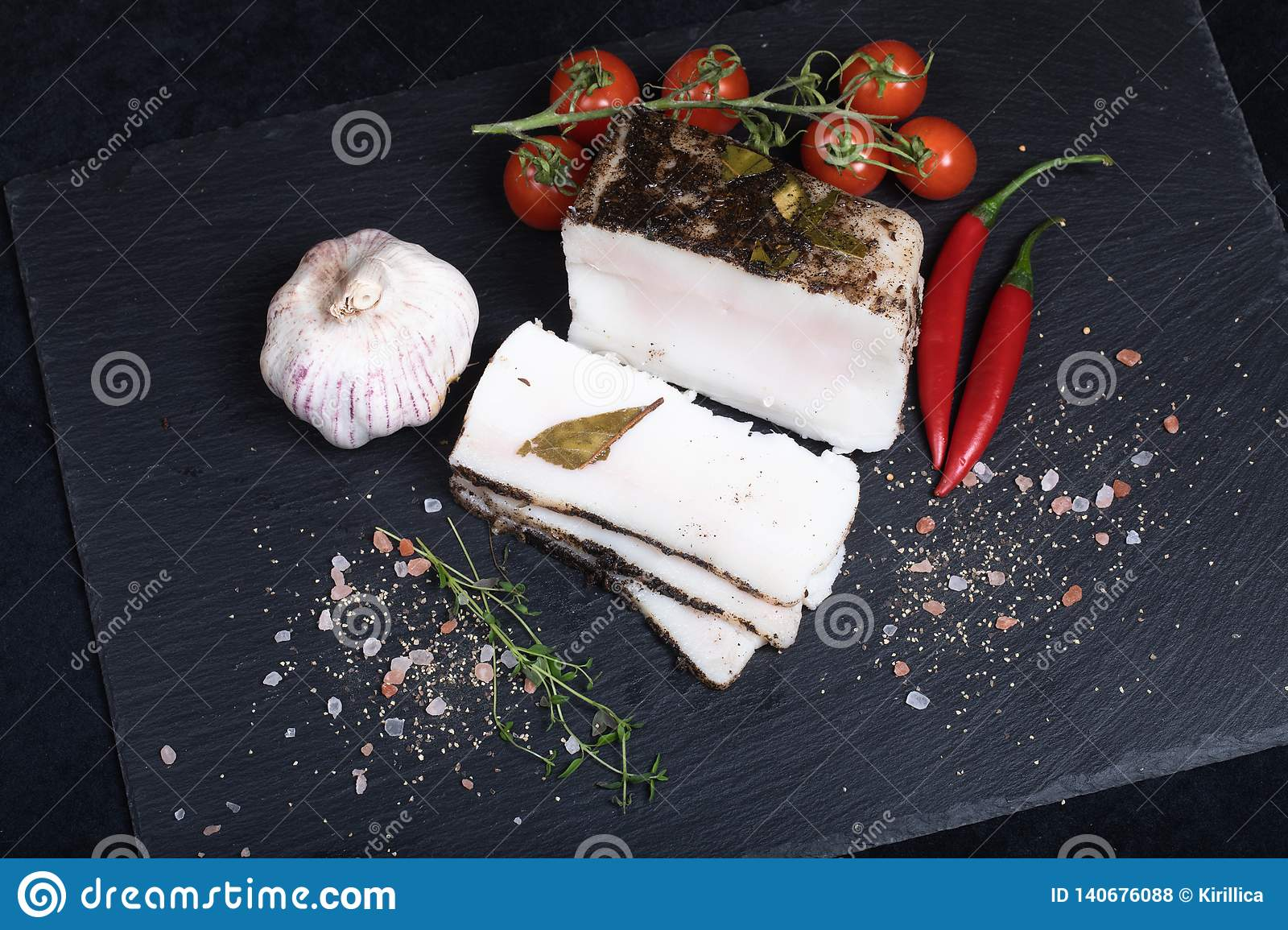 Seasoned lard on black stone plate