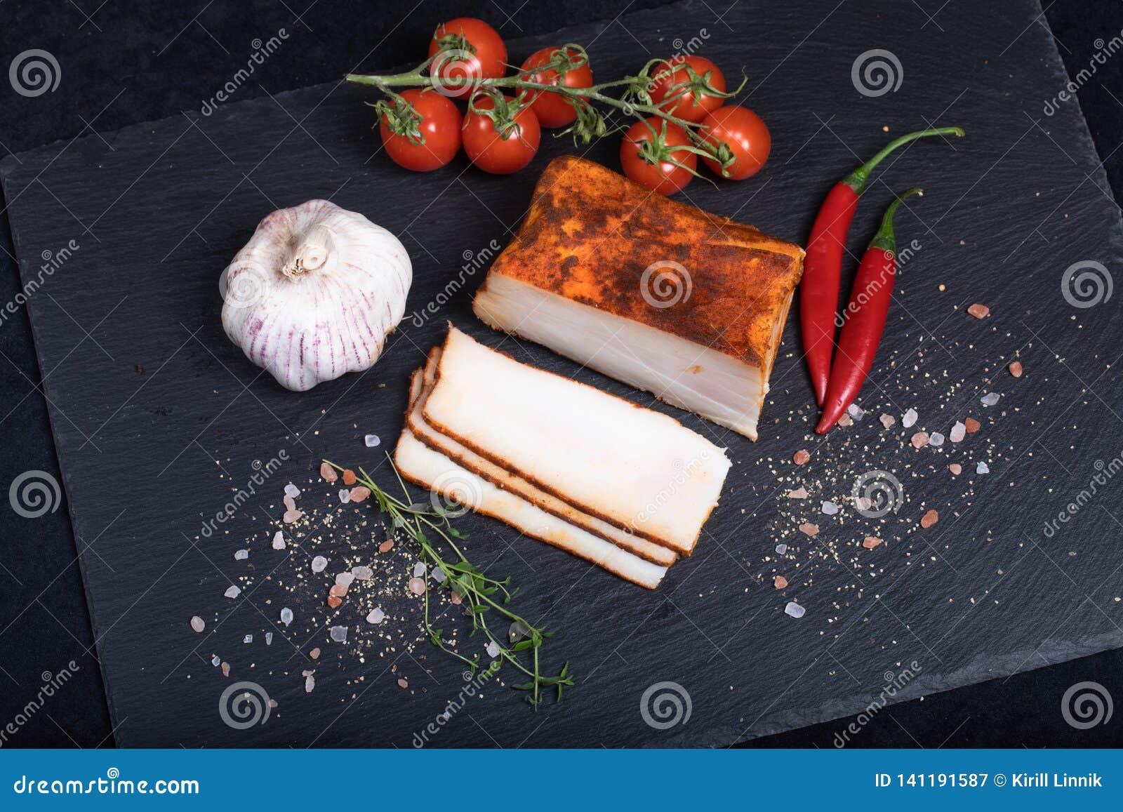 Seasoned lard on black stone plate