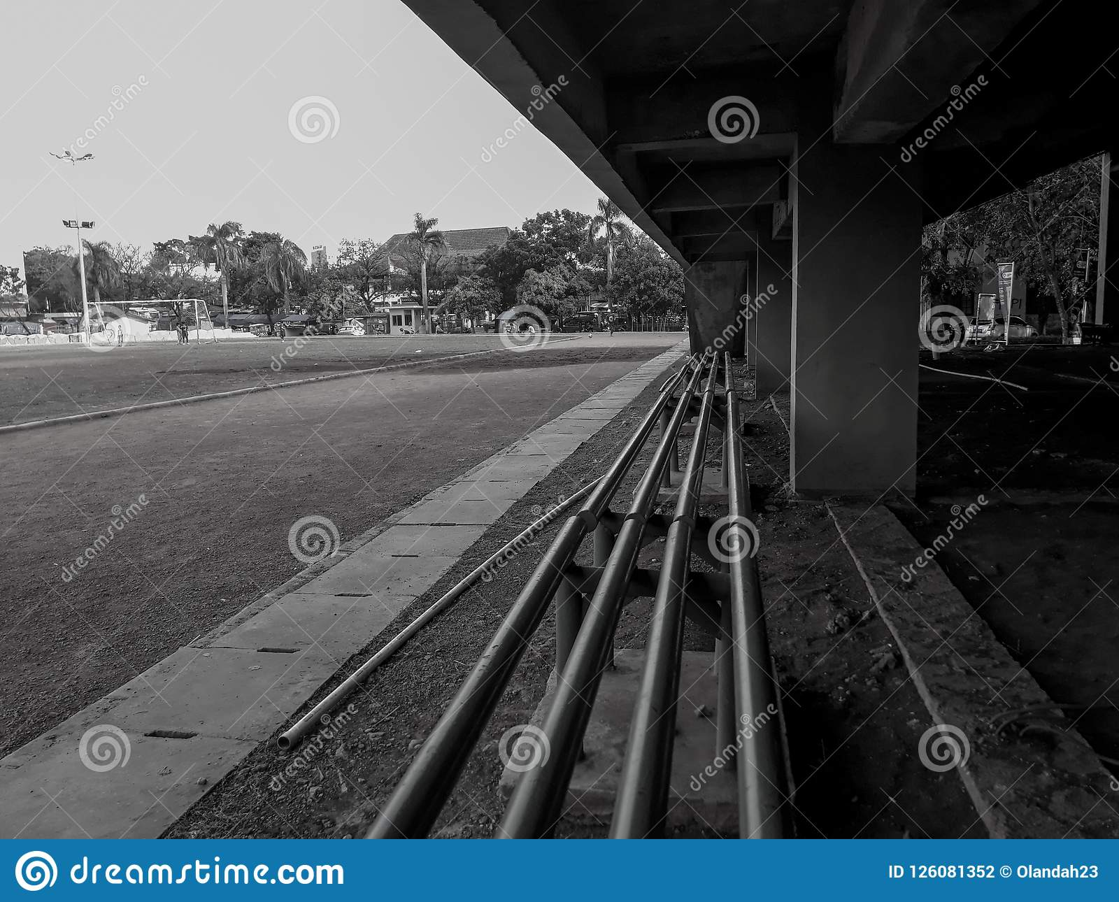 A seat on the edge of the football field. Black and white