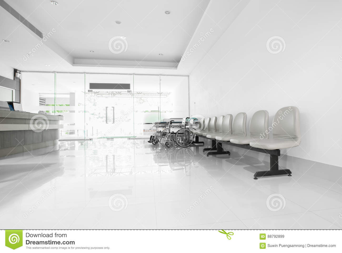 Seats and wheelchair in hospital hallway