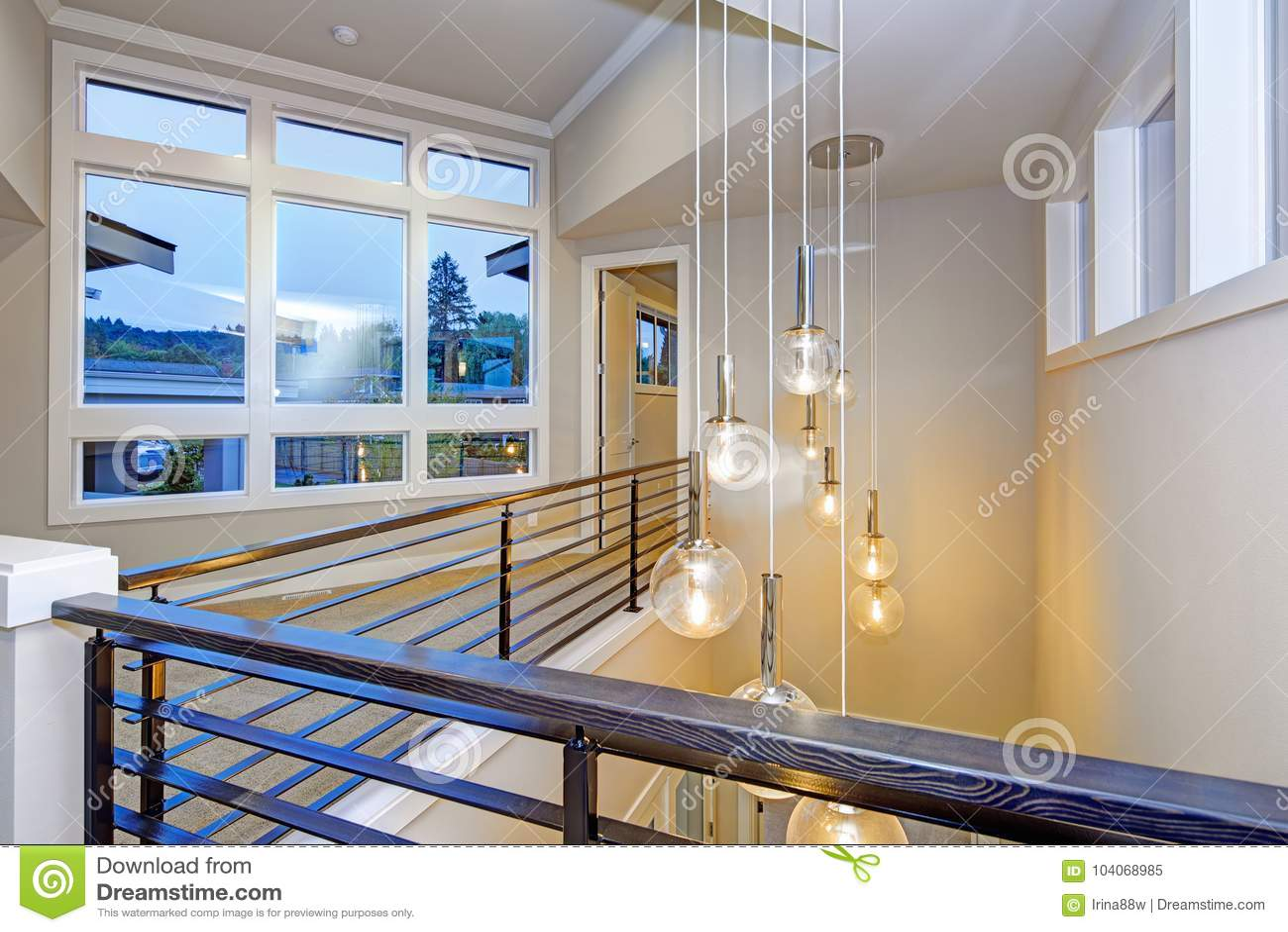 Second floor landing illuminated by beautiful chandelier