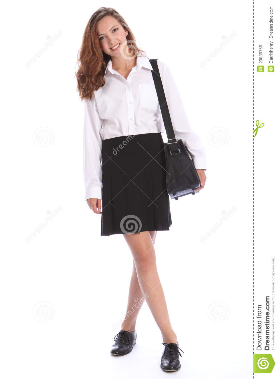 b3f314e6a Happy smile from beautiful teenage secondary school student girl wearing  black and white school uniform, bag over her shoulder.