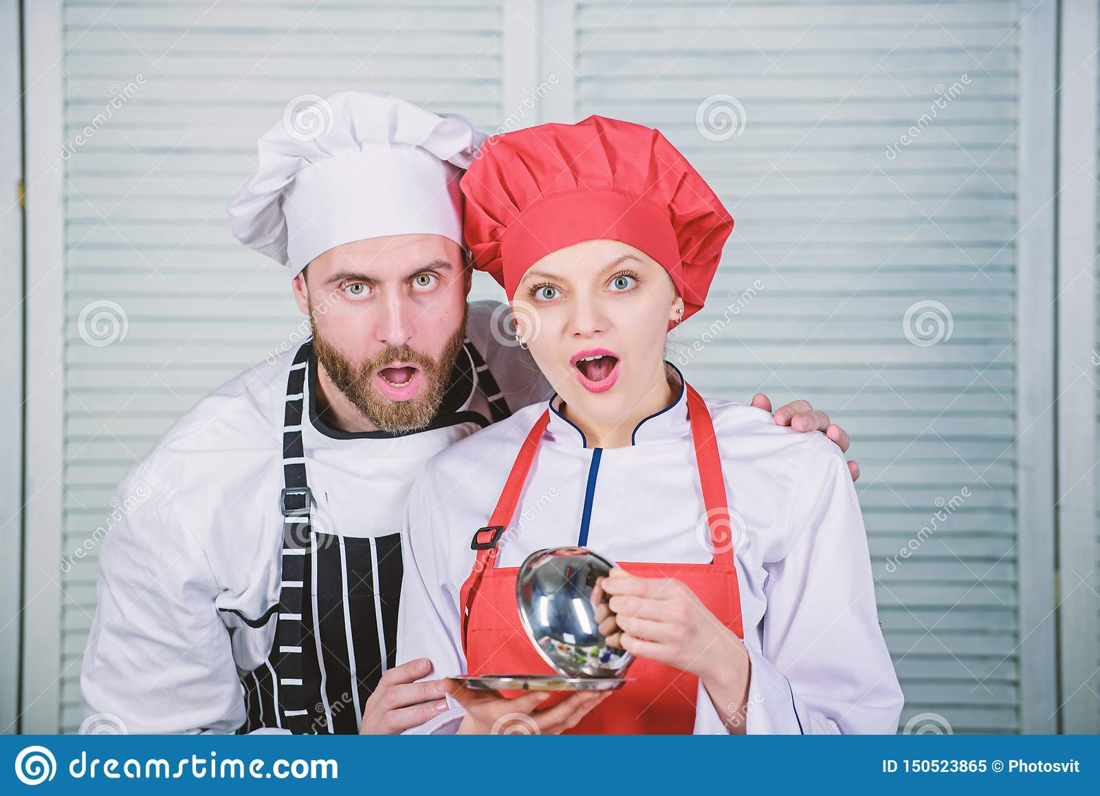 Secret ingredient by recipe. cook uniform. couple in love with perfect food. Menu planning. culinary cuisine. Family