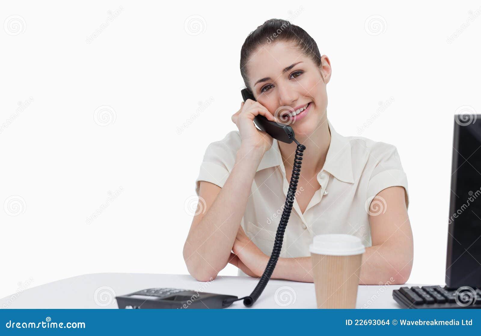 Secretaria sonriente que contesta al tel fono imagenes de for Ministerio de seguridad telefonos internos
