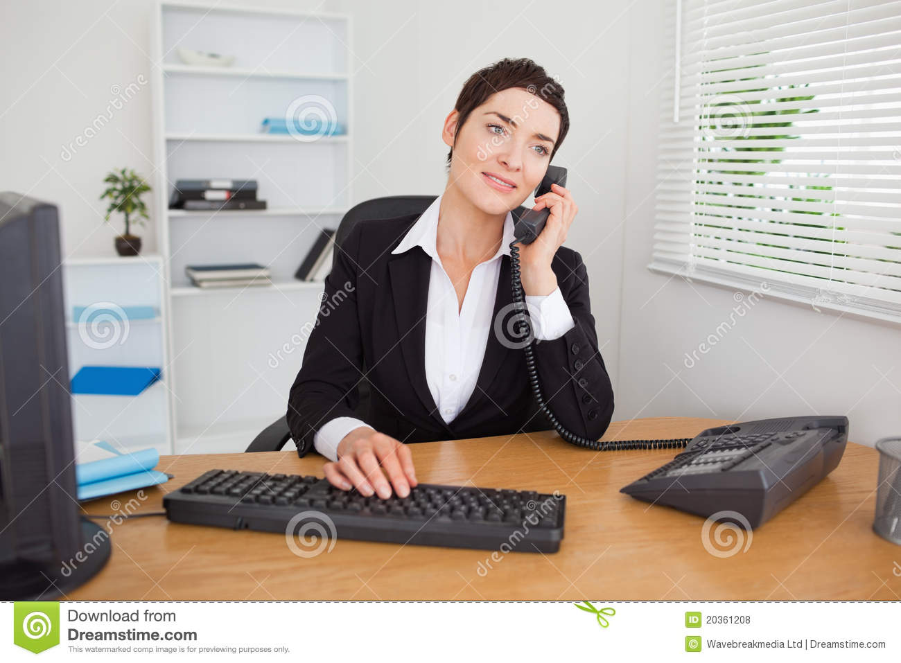 Secretary answering the phone