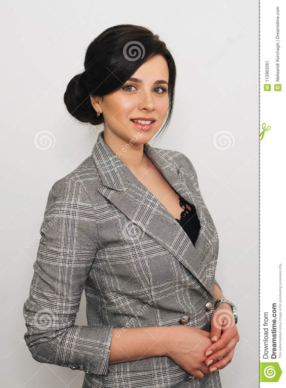 Secretary Girl Of Caucasian Appearance In Business Suit With Smile