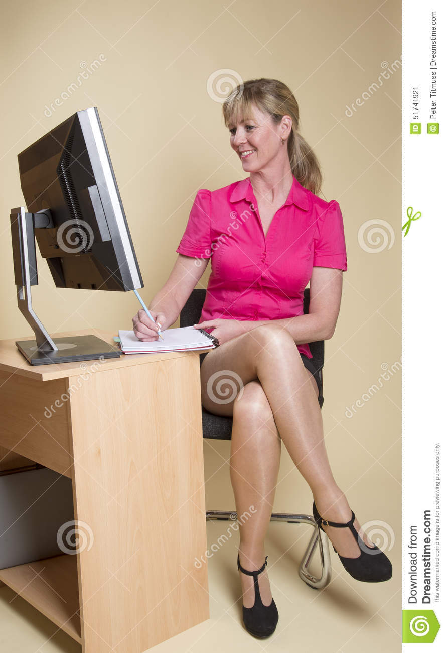 secretary making notes from computer screen stock image - image of