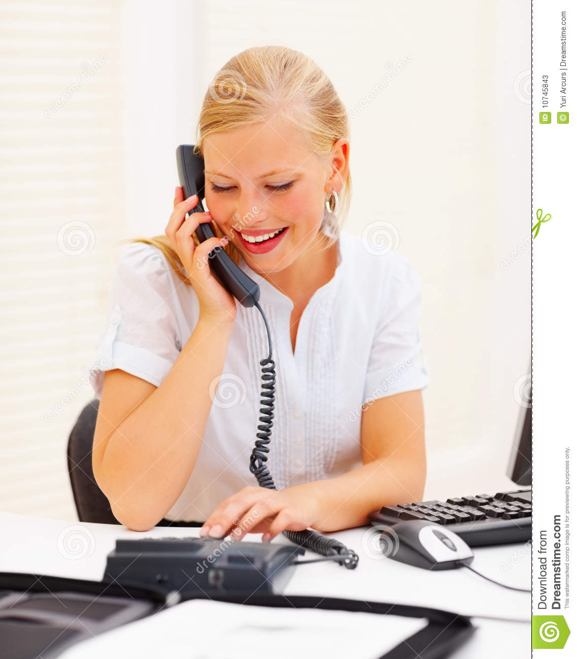 Stock Photos: Secretary using a telephone in office. Image: 10745843
