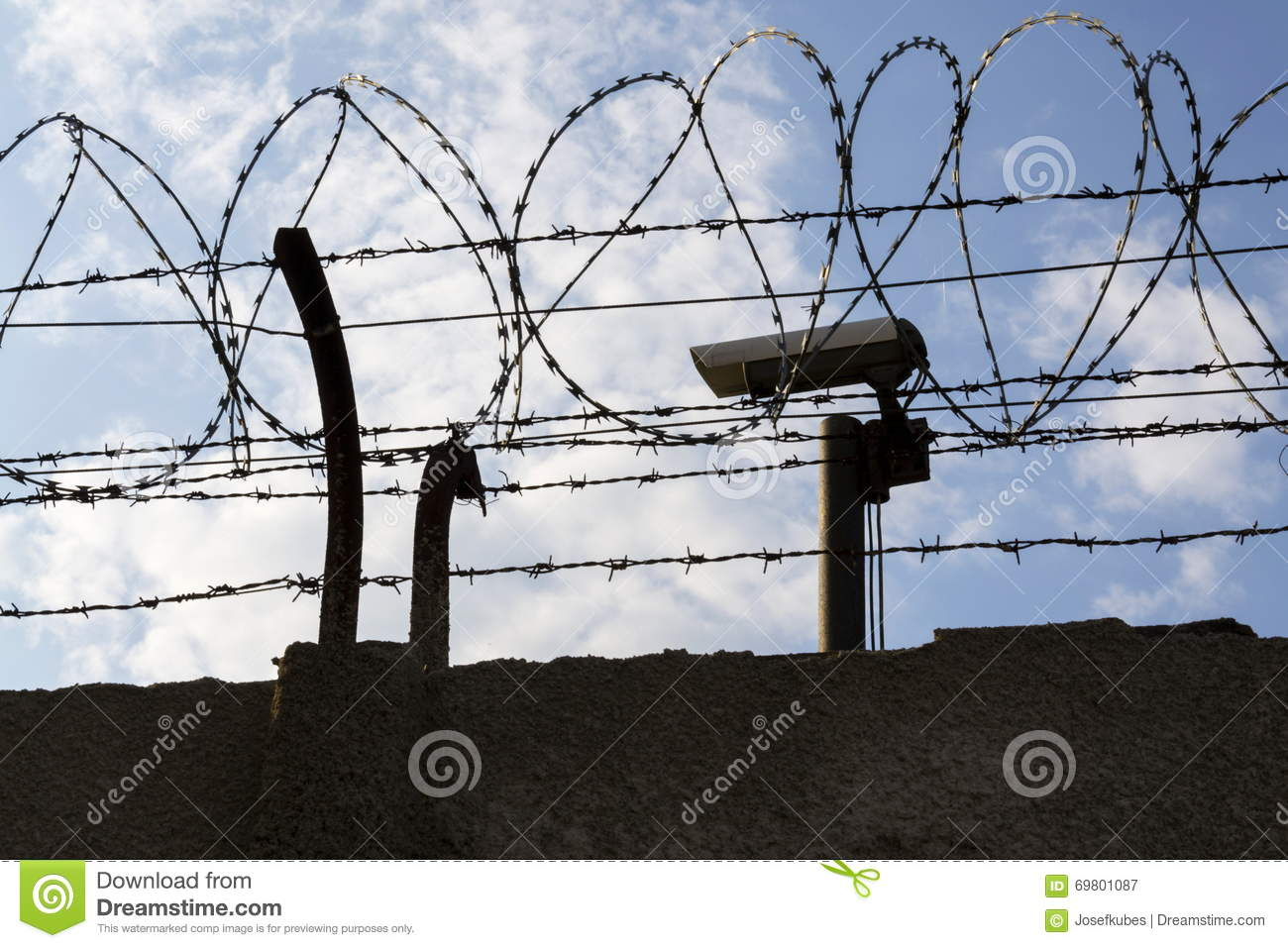 Security Camera Behind Barbed Wire Fence Around Prison Walls Stock ...