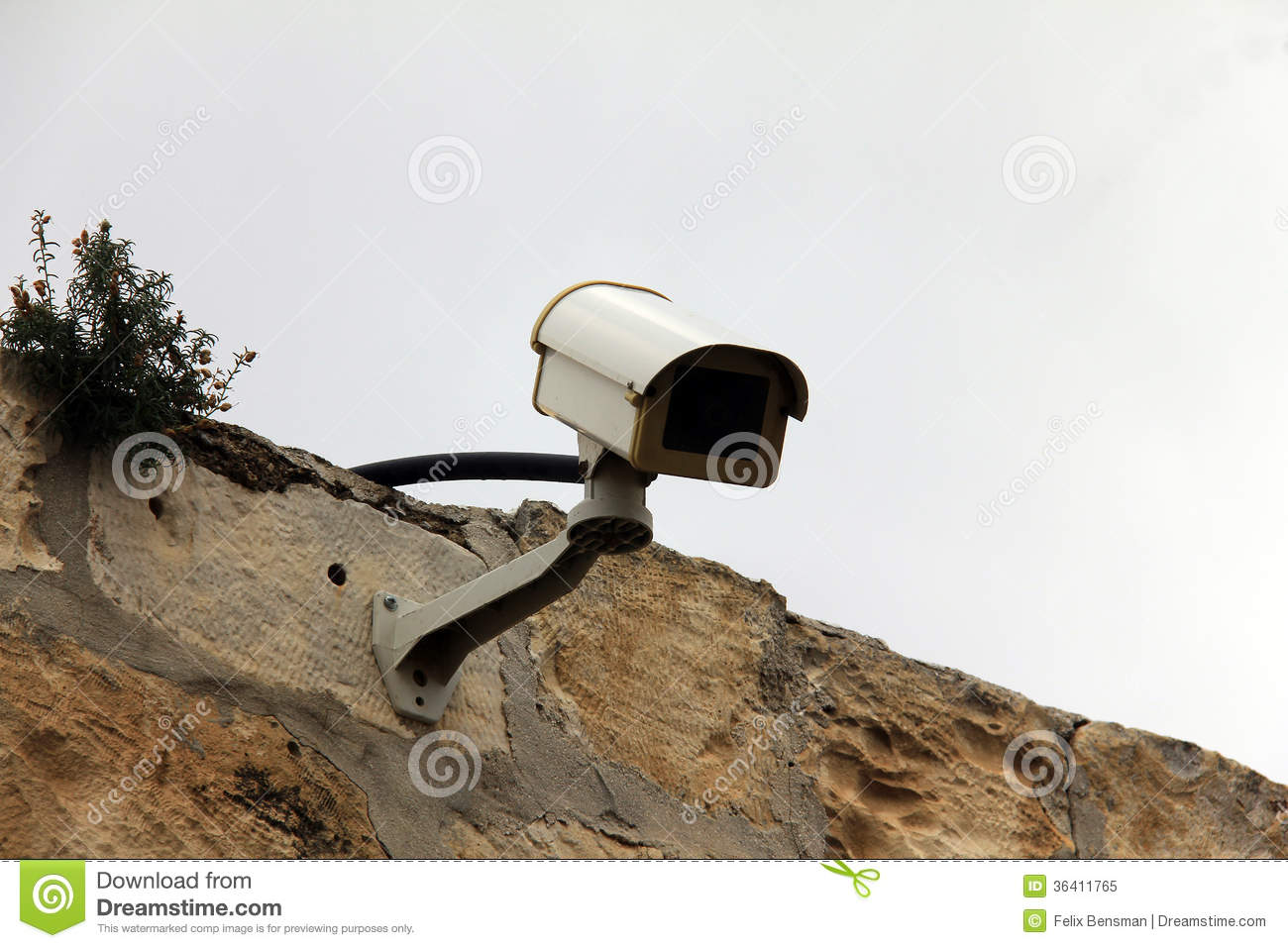 Rock Camera Surveillance : Security cameras fitted to a roof against a winter sky. stock image