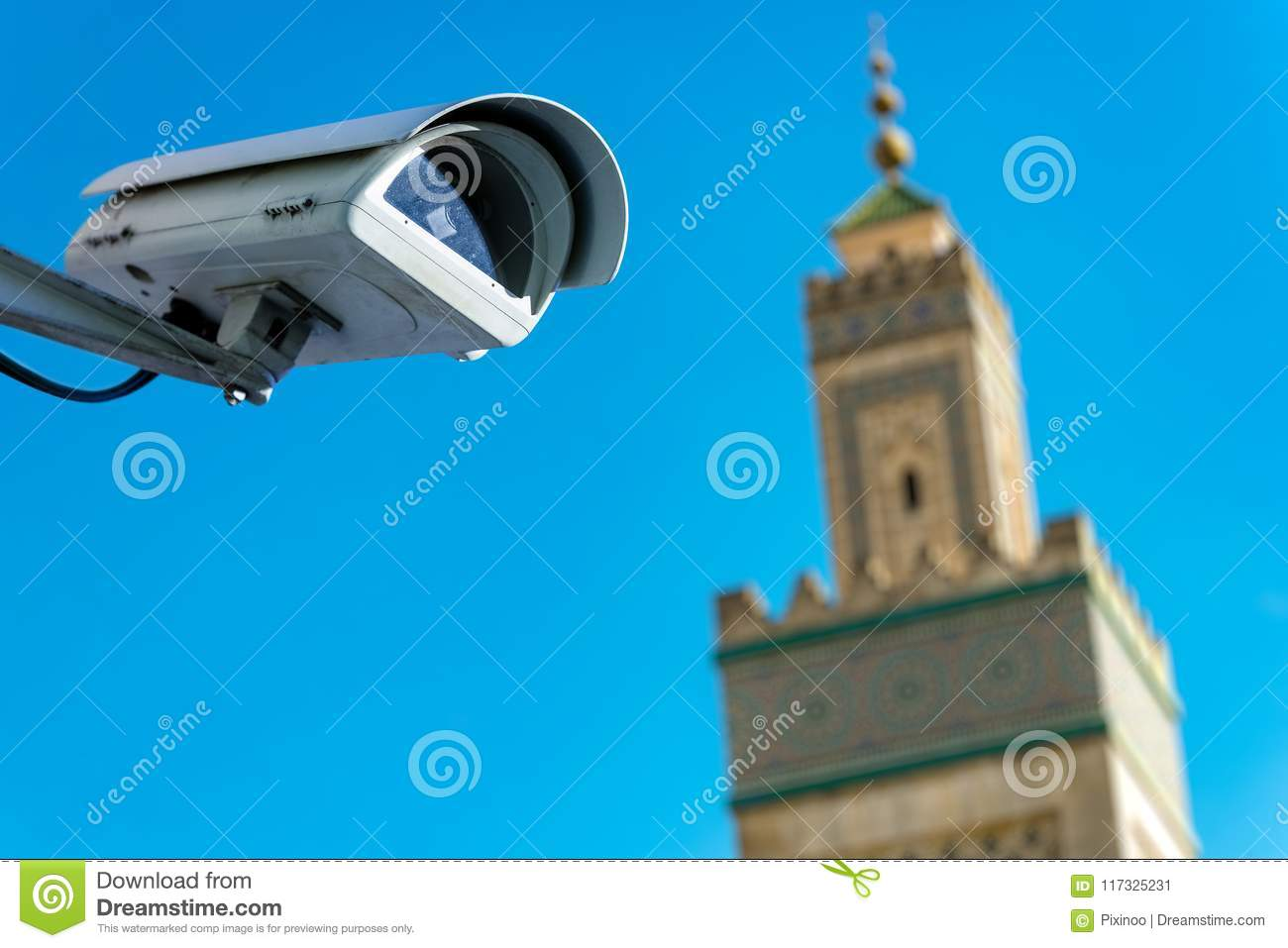 security CCTV camera or surveillance system with mosque on blurry background