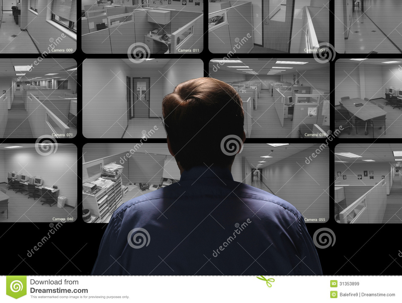 Security guard conducting surveillance by watching several security monitors